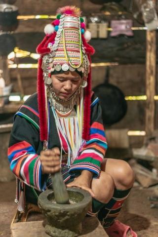 Tribal woman preparing food