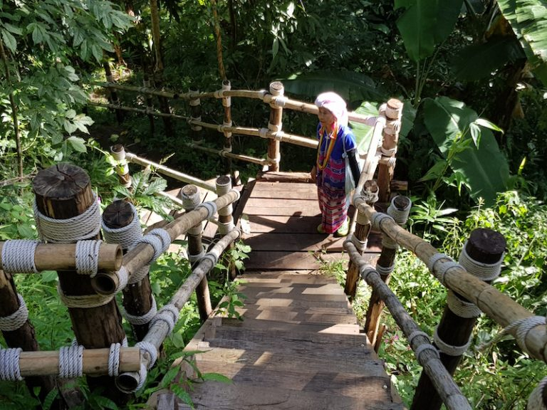 woman in traditional dress on staircase Pha Dok Siew Trail
