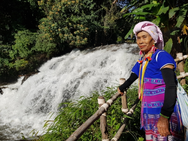 Tribal guide at a waterfall