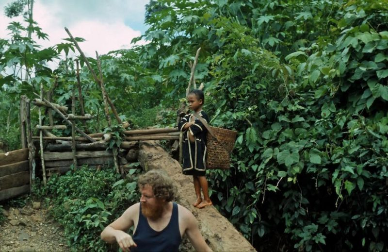 Tourist with hilltribe child