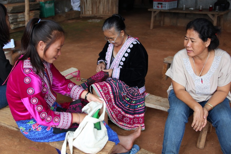 Hmong ladies working on textiles