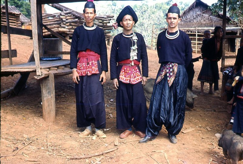 Two tribal men and a foreigner