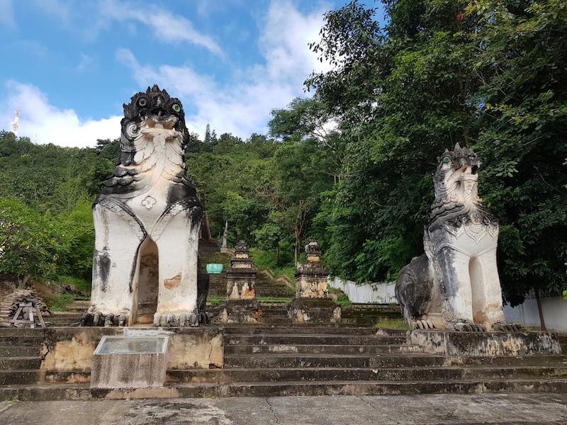 Statues at the base of a staircase