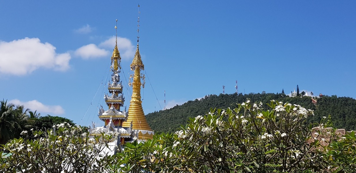 Temple in the foreground with mountain in the back