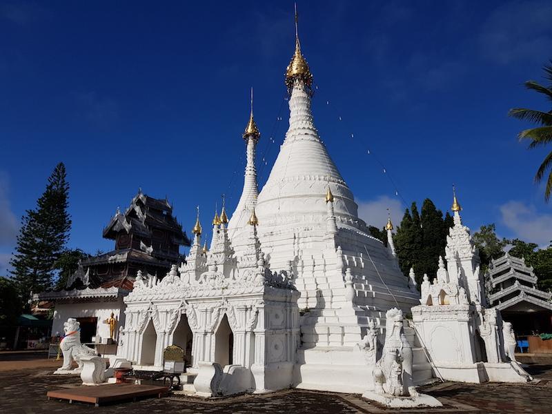 White chedi of Buddhist temple