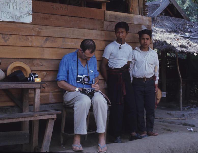 Man with camera idn village